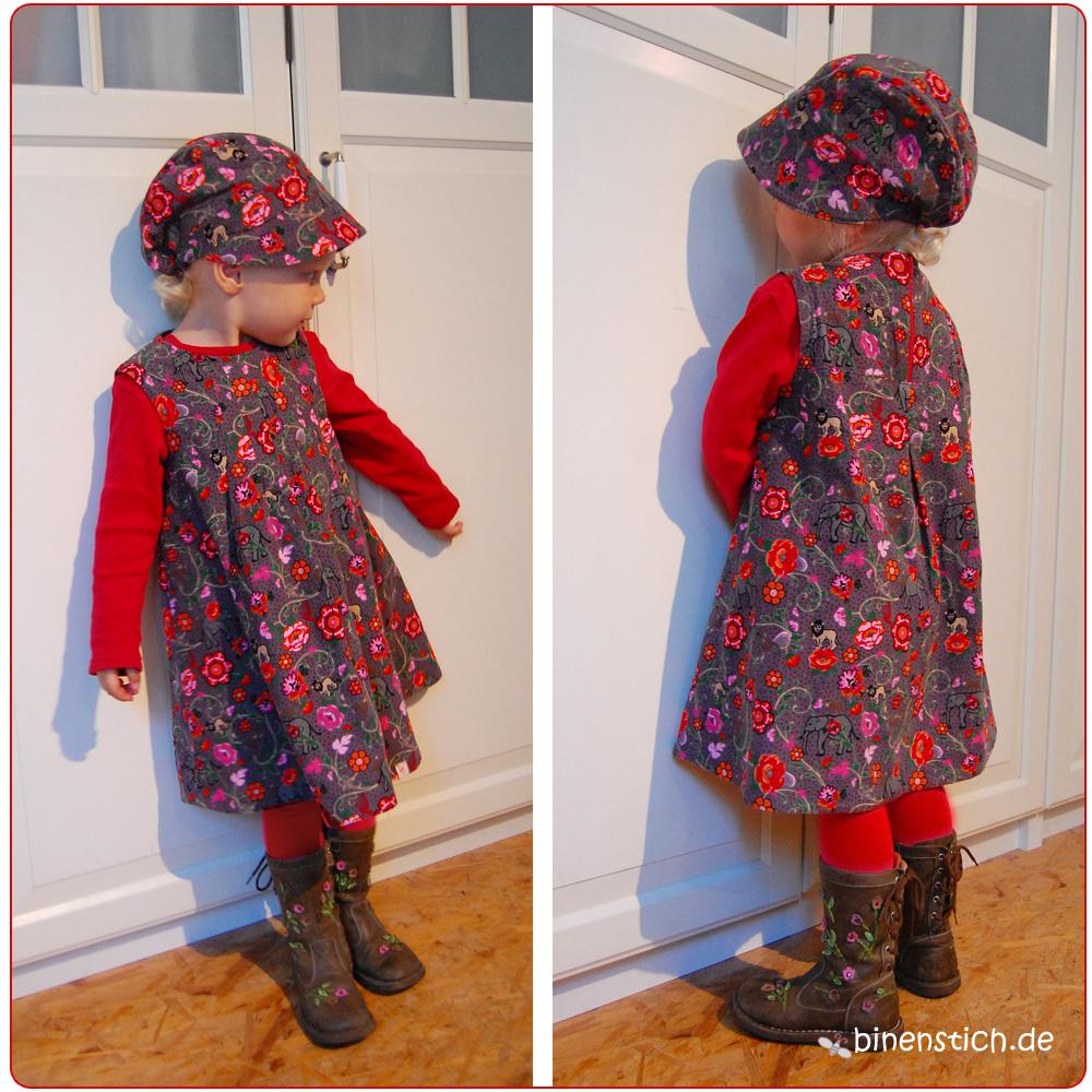 Das Kind trägt: Knip-Kleidchen und Bengel-Mütze | Binenstich